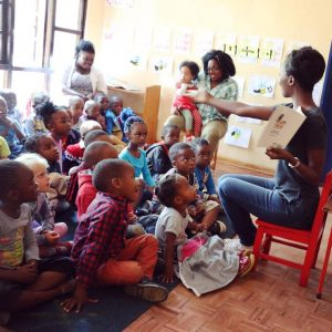 Taku reading to kindergarten kids in Harare, Zimbabwe